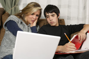 Mother and teen son doing homework
