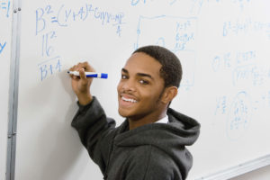 Adult student at white board