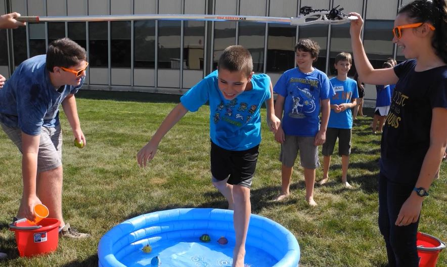 Volunteers with campers playing water games